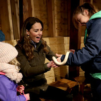 Duchess of Cambridge holds snake on trip to Co Down farm