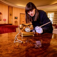 Gold telephone returns to Art Deco mansion after being found in skip