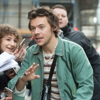 Harry Styles greeted by fans after performing songs from new album