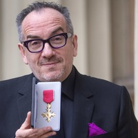Elvis Costello hails 'gracious experience' as he receives OBE