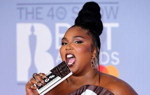 Lizzo steals the show in Hershey's gown on Brits red carpet
