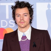 Harry Styles wears black ribbon to Brits after Caroline Flack death