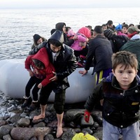 Greek police fire tear gas at migrants trying to cross border from Turkey