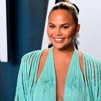 Chrissy Teigen says she is torn over undergoing further breast surgery