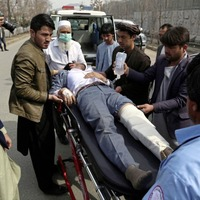 Gunmen kill at least 27 at remembrance service for Shiite leader in Afghanistan