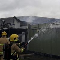 Popular west Belfast bar destroyed in blaze 'will be rebuilt'