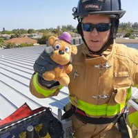 Police and fire crews join forces to rescue boy's teddy from roof