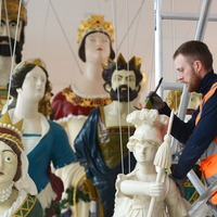 Restored figureheads from 19th-century warships go on display