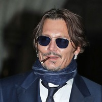 Johnny Depp wants libel case delayed because he's a coward, High Court hears