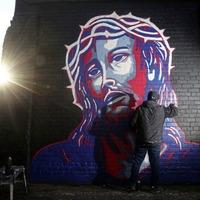 Belfast street artist hopes Obama style art on peaceline will be 'message of hope'