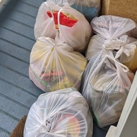 Refugee family brings food to self-isolating family who sponsored their move