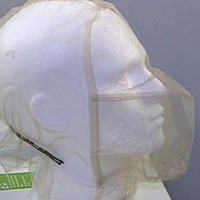Spit guards on police suspects 'not an effective means to prevent Covid-19'