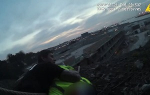 Dramatic footage shows officers using belts to rescue man from 50ft cliff