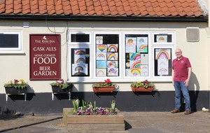 Closed pub raises charity money with rainbow drawings from locals