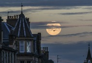 Stargazers marvel at emerging pink supermoon in skies above UK
