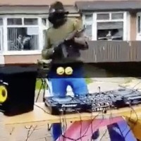 Masked and armed man DJs in front of children in Ardoyne