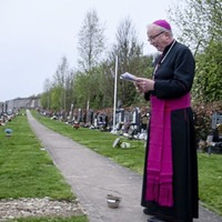 Bishop Donal McKeown blesses graves in moving dawn ceremony