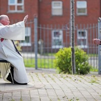 Socially-distanced queues in west Belfast as priest hears confessions