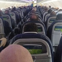Coronavirus: Concerns raised after images emerge of packed Aer Lingus flight from Belfast to London