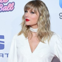 Taylor Swift raises a glass as fans speculate new music is imminent