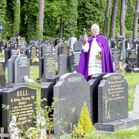 Bishop of Down and Connor privately blesses graves at Milltown and City cemeteries