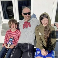 Portrush man conquers one-man 'Ironman' challenge in his garage to raise vital funds for charity