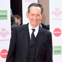Richard E Grant in leopard print and heavy make-up as drag queen in Jamie movie