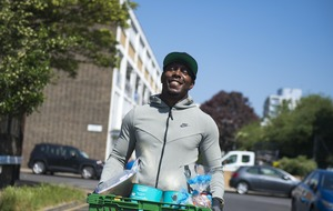 Dizzee Rascal helps distribute food parcels in community where he grew up