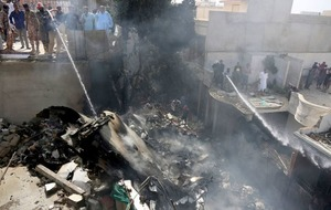 Dozens killed as Pakistan International Airlines plane crashes near Karachi