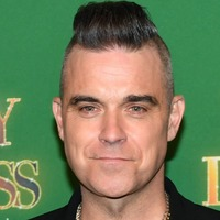 Robbie Williams reveals his father has been diagnosed with Parkinson's disease