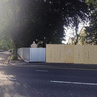 Belfast's Chinese Consulate erects wooden hoarding as wall row rumbles on