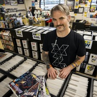 Comic book shop owner 'delighted to be back'