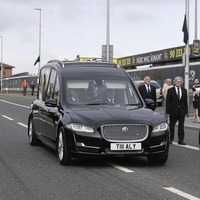 Hundreds line the route as Bobby Storey's remains returned to west Belfast
