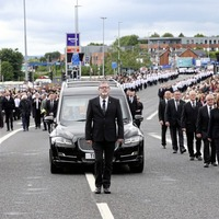 Hundreds gather in west Belfast for funeral of veteran republican Bobby Storey