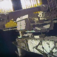 Spacewalking astronauts carry out battery replacements on ISS
