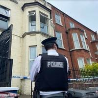 Suspected arson attack at south Belfast flats