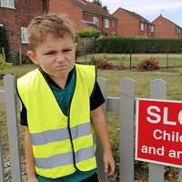 Seven-year-old boy polices drivers speeding along his road with 'stern glare'