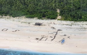Men rescued from uninhabited Pacific island after writing SOS in sand