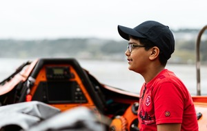 Boy 'who was moments from dying' thanks lifeboat crew