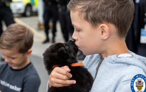 Boy with rare condition plays with police pups as part of 'bucket list' wish