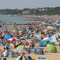 In Pictures: Sun-seekers make most of heatwave ahead of storms