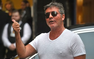 Simon Cowell had six-hour surgery after breaking back in bike fall