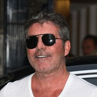 Simon Cowell tweets update after breaking part of his back in bike fall