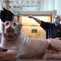 Specialists work to remove lockdown dust from exhibits at the British Museum
