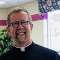 Prayers offered for Belfast priest missing after boat capsizes in Detroit