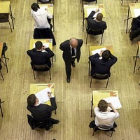Exam board chief apologies for grading controversy