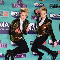 Jedward criticise guitarist Jim Corr over support for anti-mask protests