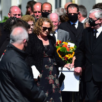 Sea crash tragedy siblings found clinging to each other, mourners told