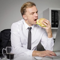 The real reason why eating at your computer screen could be making you fat