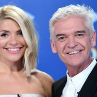 Holly Willoughby and Phillip Schofield reunite with hug through 'cuddle curtain'